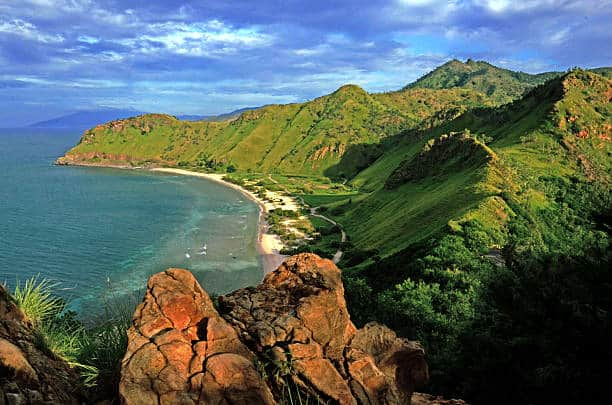 green mountains with blue water in east Timor coastline