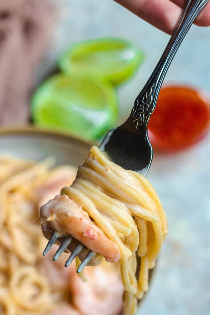 fork full of bang bang shrimp pasta