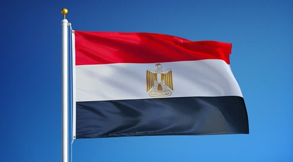 egyptian flag in front of a blue sky
