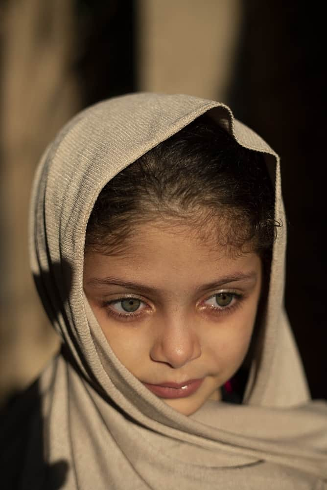 Egyptian girl with green eyes and head scarf