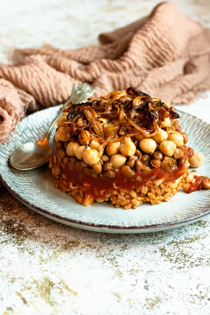 Koshari recipe from Egypt layered on a plate