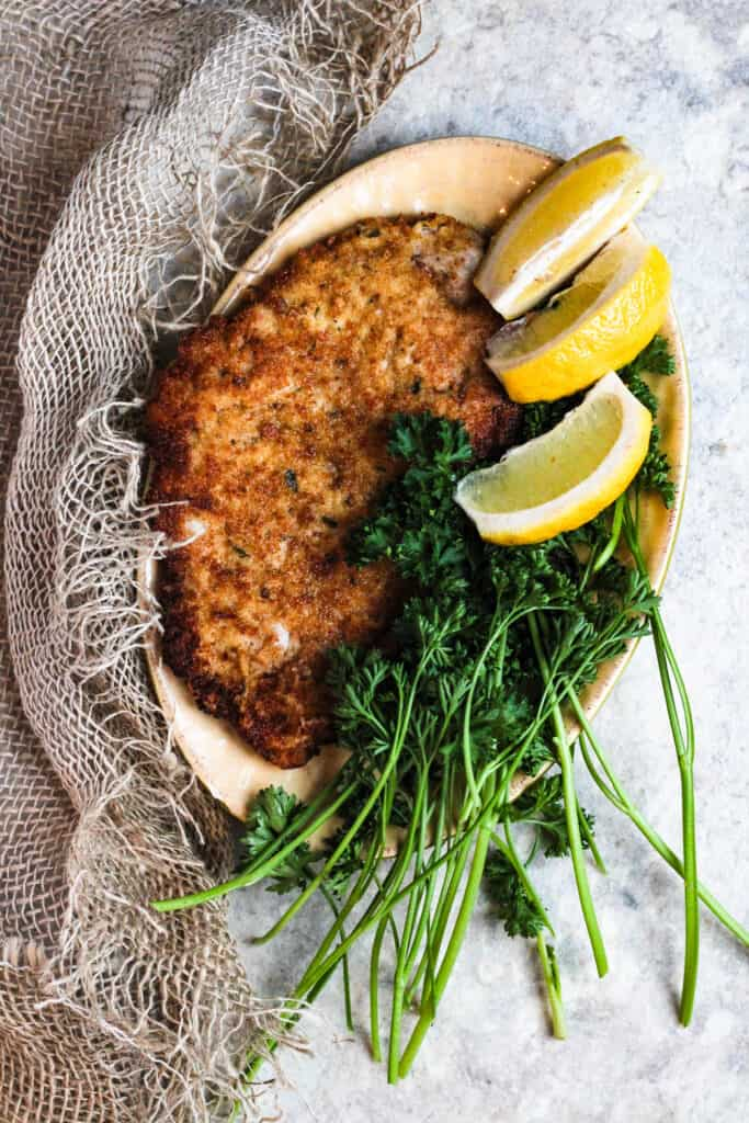 Wiener Schnitzel plate with parsley and lemon