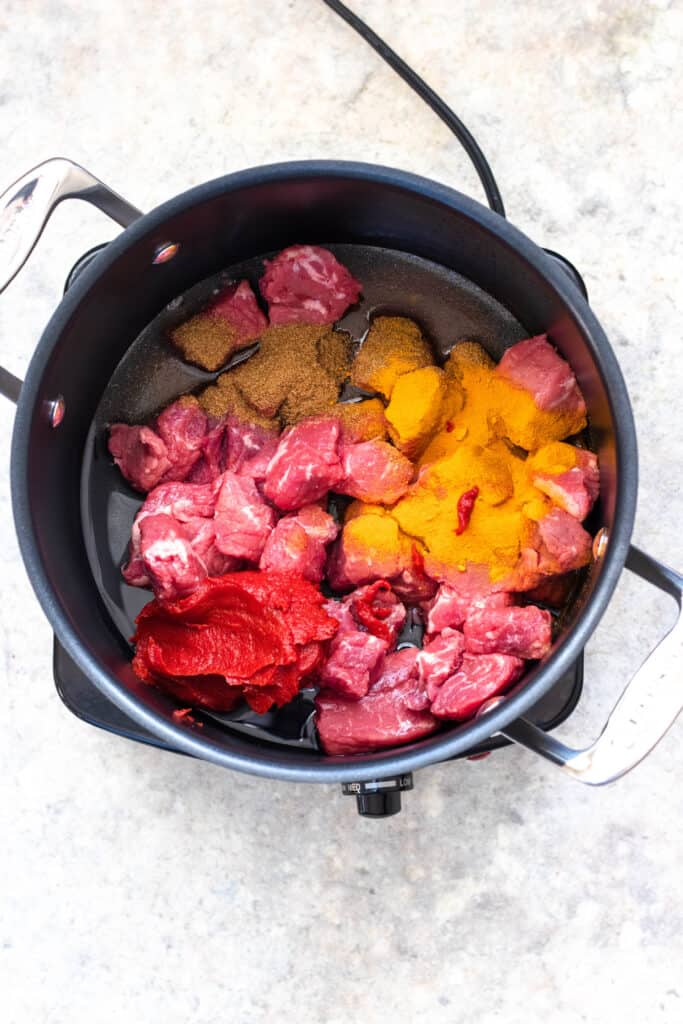 beef with seasonings in a pot