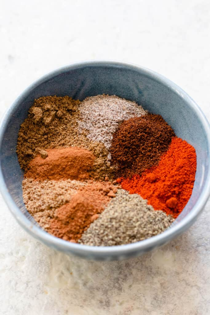 Many spices in a mixing bowl