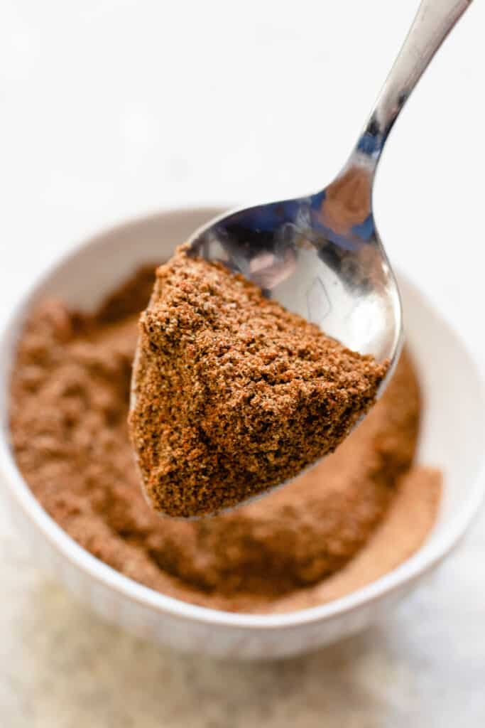 Spoon holding Baharat spice blend