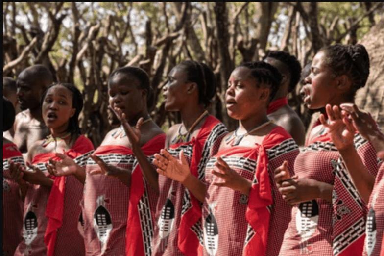 women singing in red robes in Eswatini