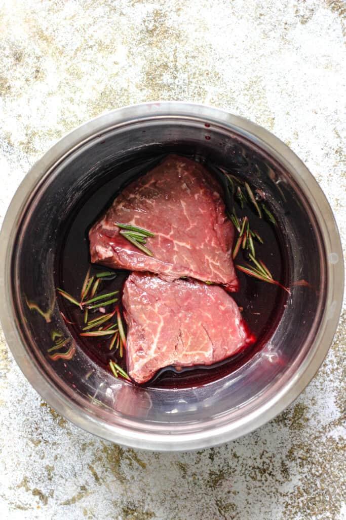 Filet steaks marinating in red wine