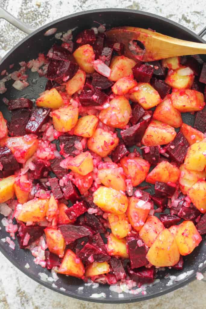 skillet full of beets and potatoes