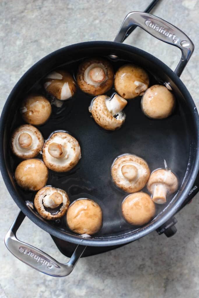 Boiled mushrooms in a pot