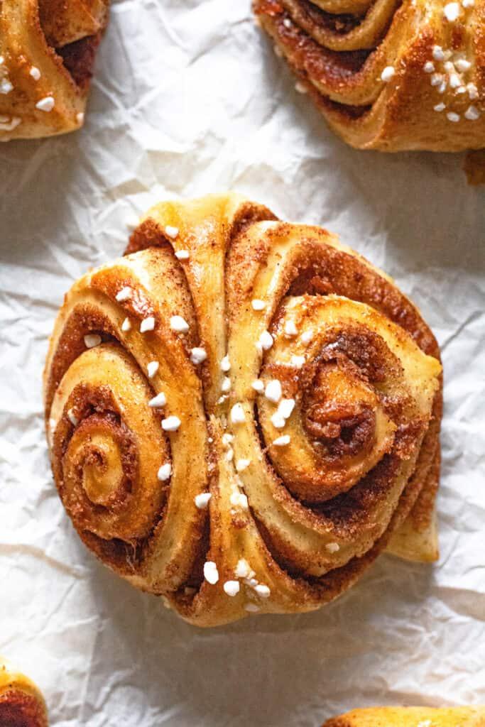 Cinnamon bun on parchment paper