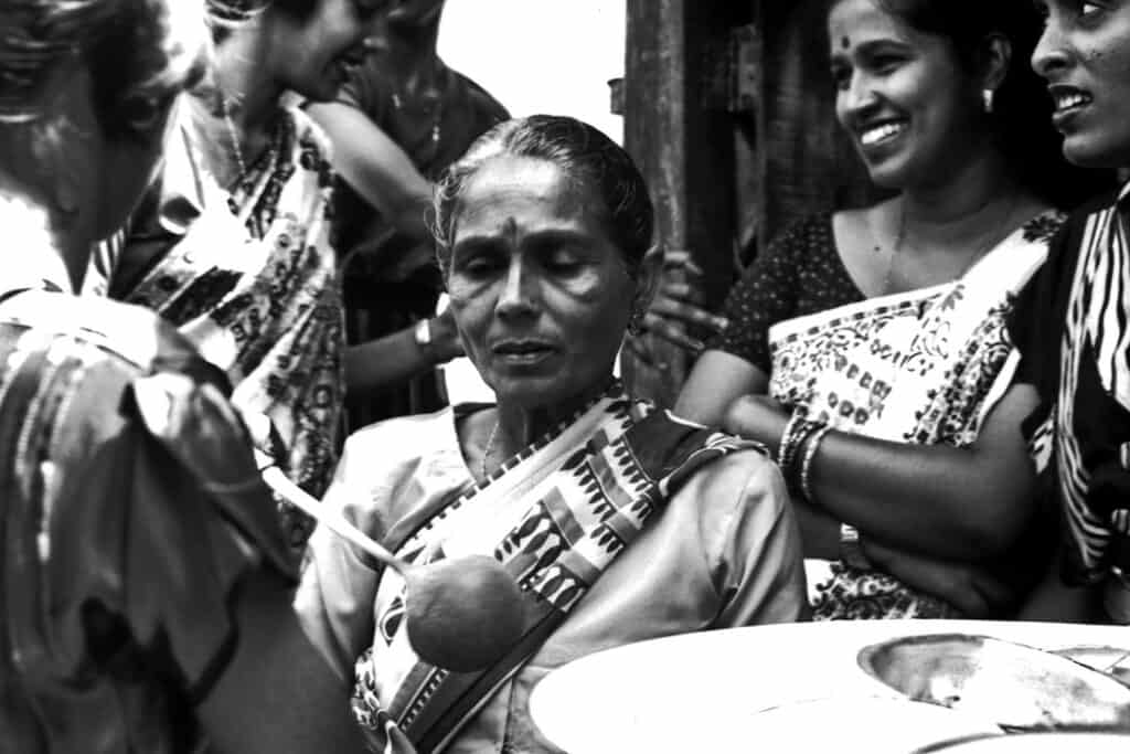 Black and white photo of Fijian woman at ceremony