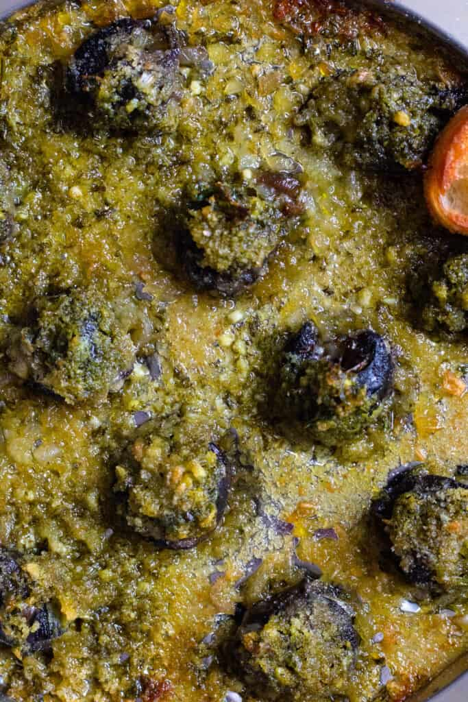 close up of escargot cooked in garlic butter