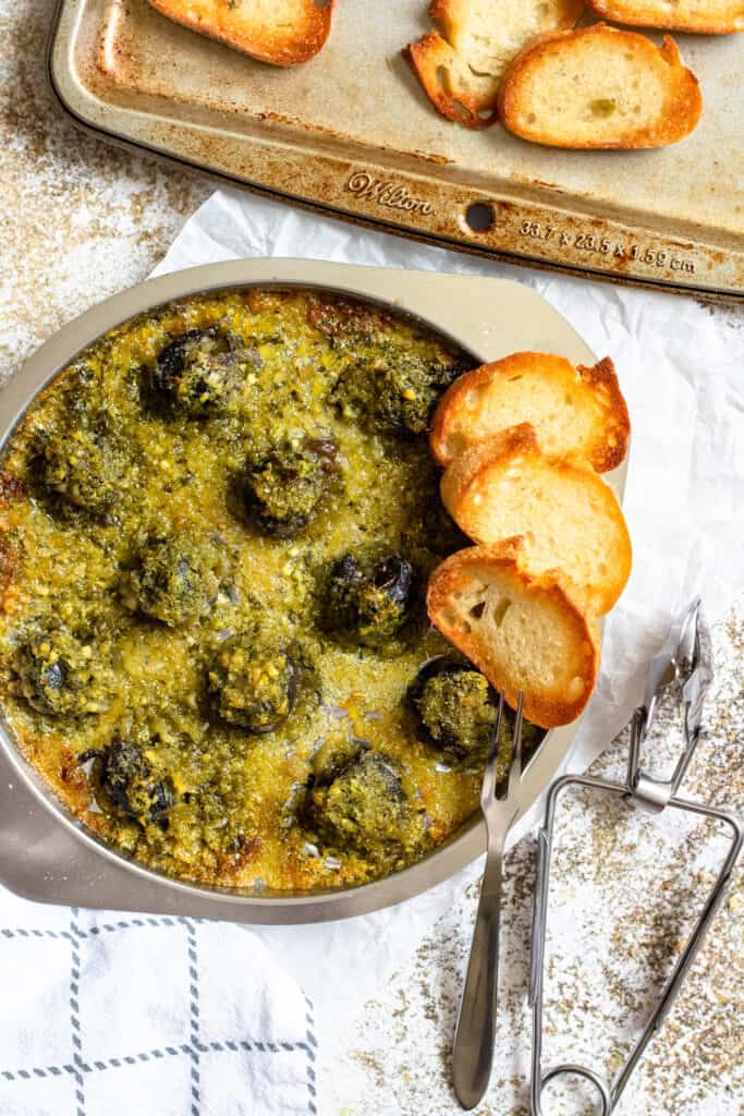 Tray of escargot with baguette slices
