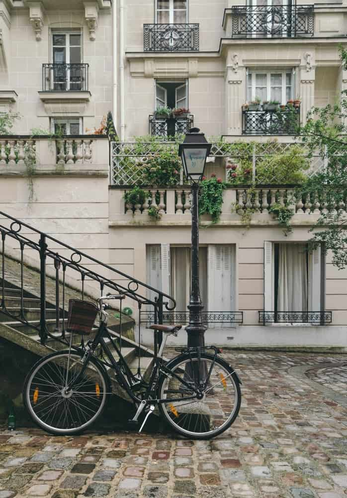 a beautiful house with a bike in front of it in france