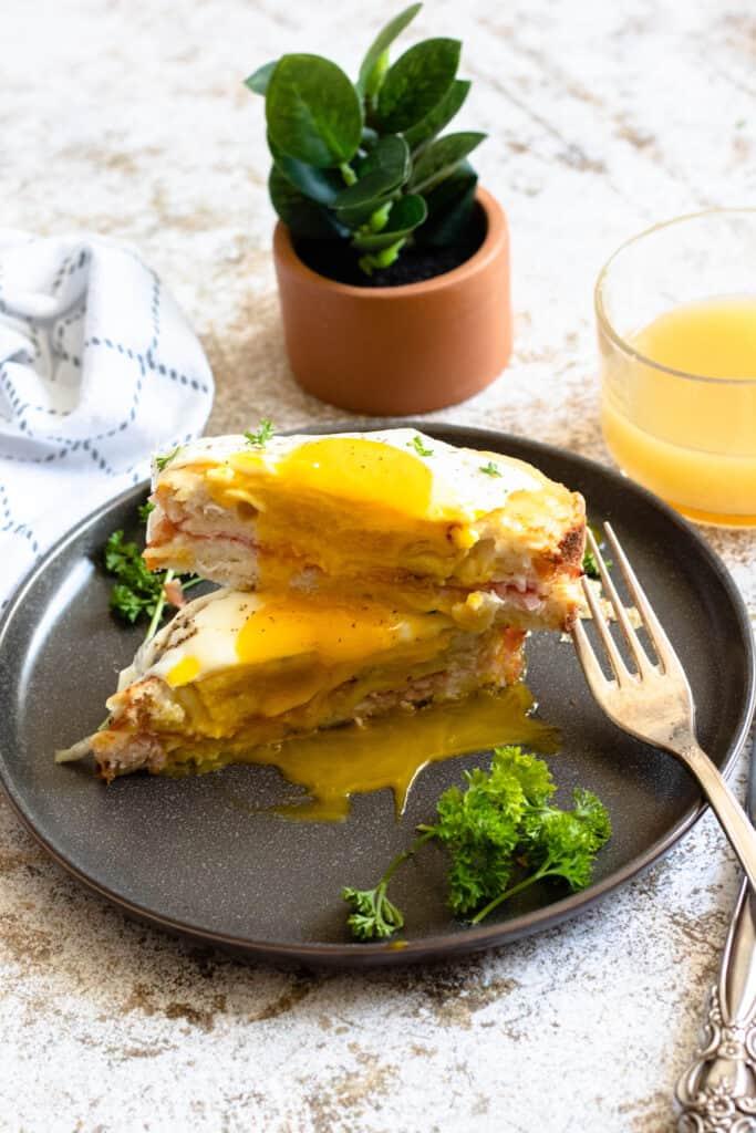 Stack of croque madame sandwich dripping yolk