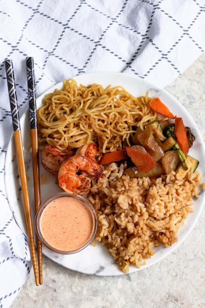 overhead of plate of hibachi food with yum yum sauce