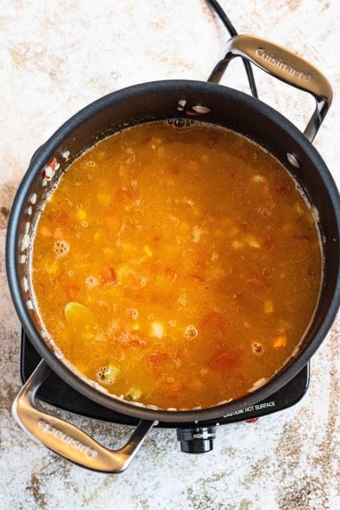 chicken broth in a  medium pot