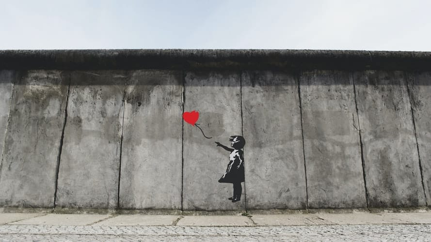 Berlin wall with red balloon painting