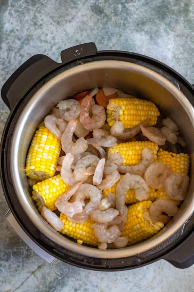 instant pot with uncooked shrimp inside