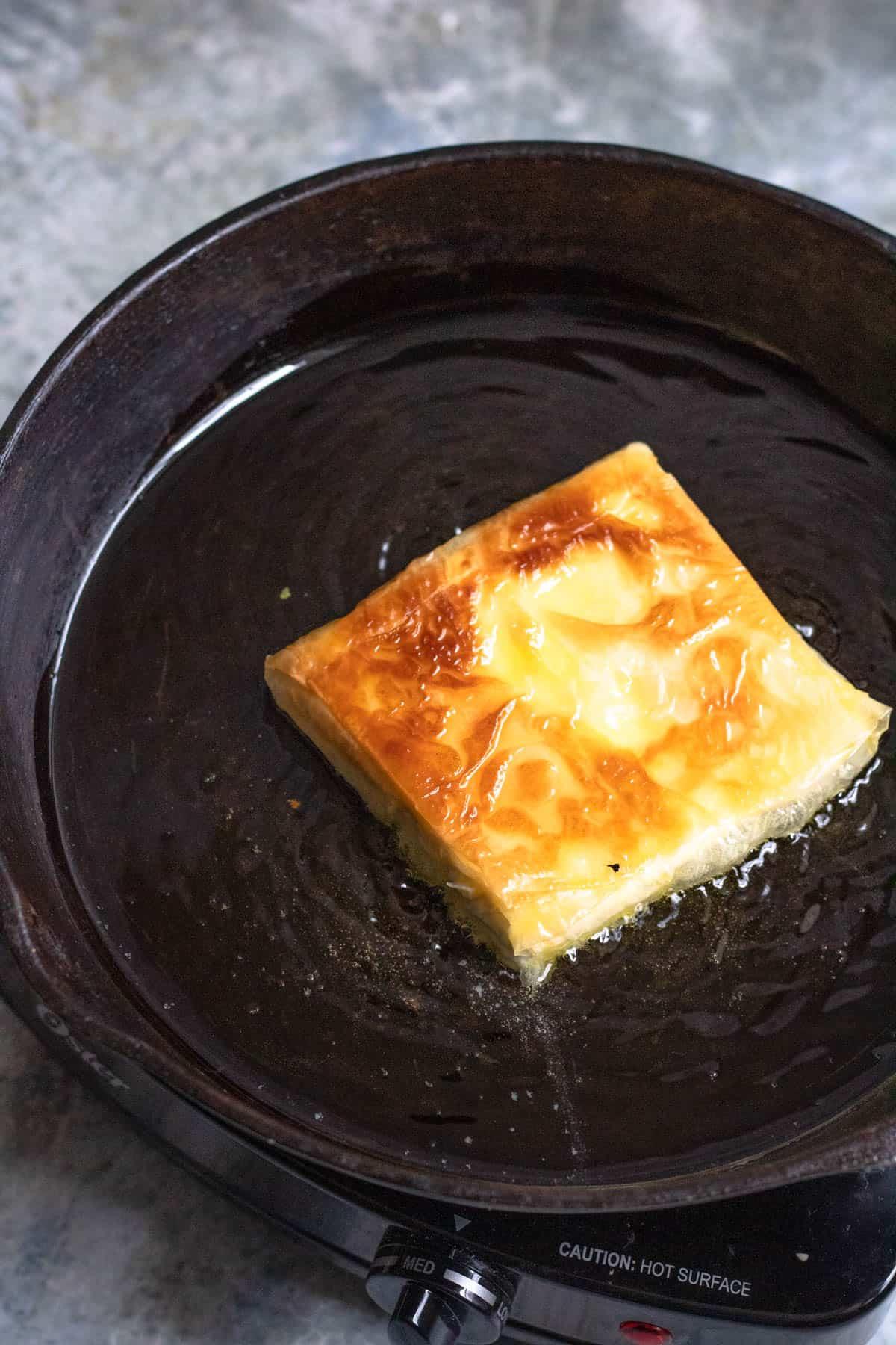 crispy feta cooking in a cast iron