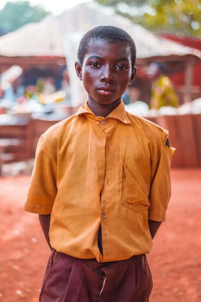 Ghanaian boy in a yellow shirt