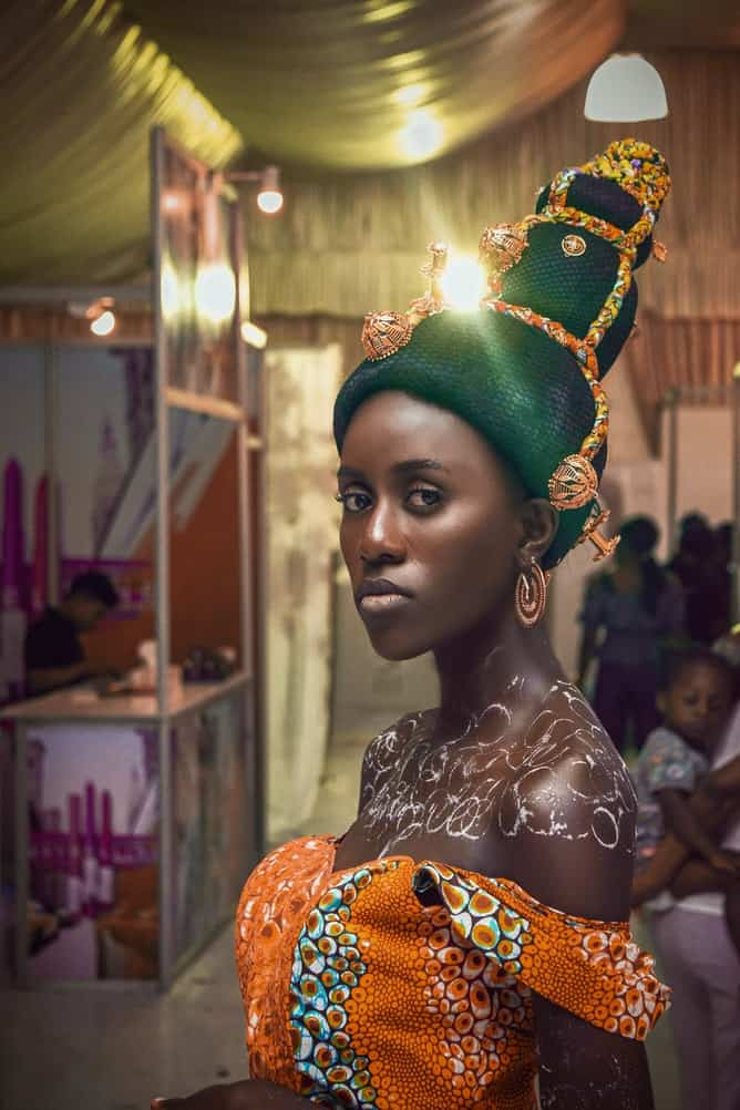 Ghanaian woman with painted body and a decorated head wrap