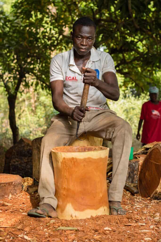 Ghanaian man pounding yams