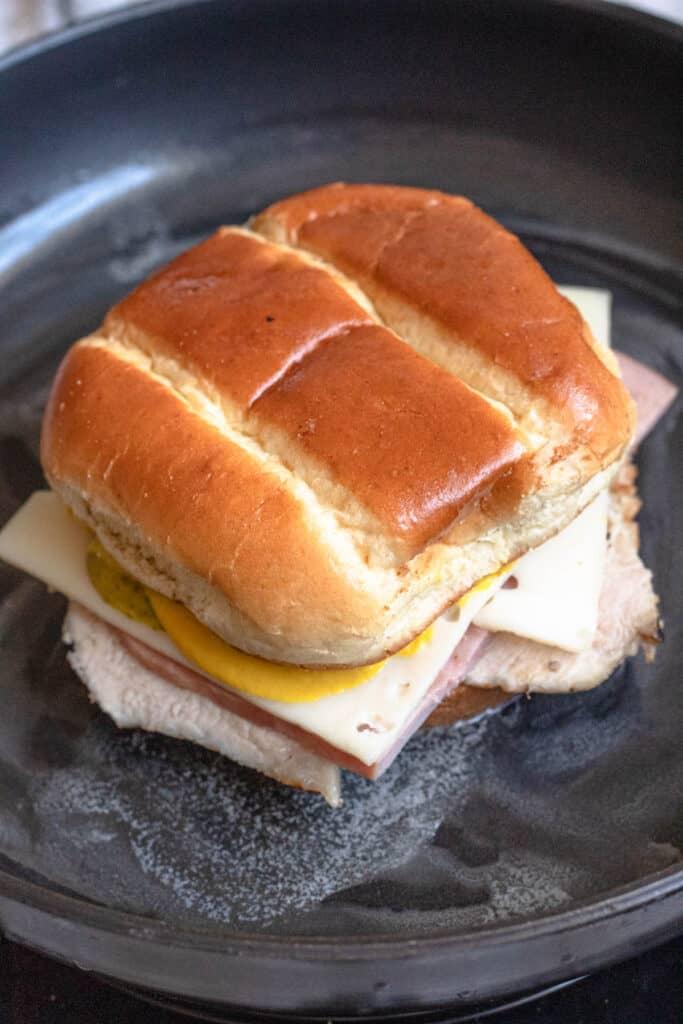 untoasted medianoche sandwich in a frying pan