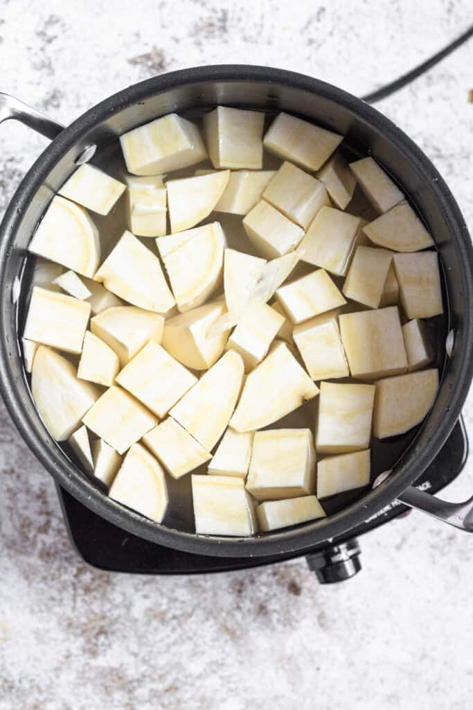 Pot with cubed yams about to be boiled