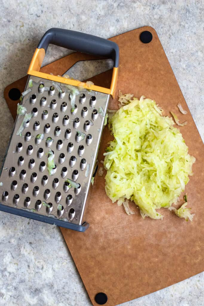 grated cucumber next to a cheese grater