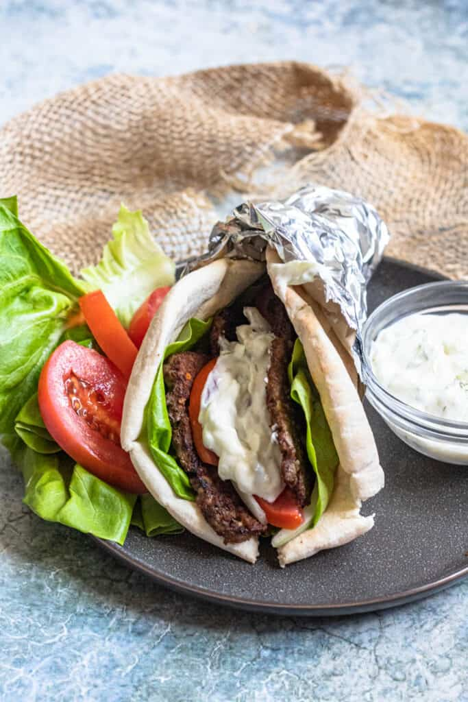 Gyro with easy tzatziki sauce on it and on the side