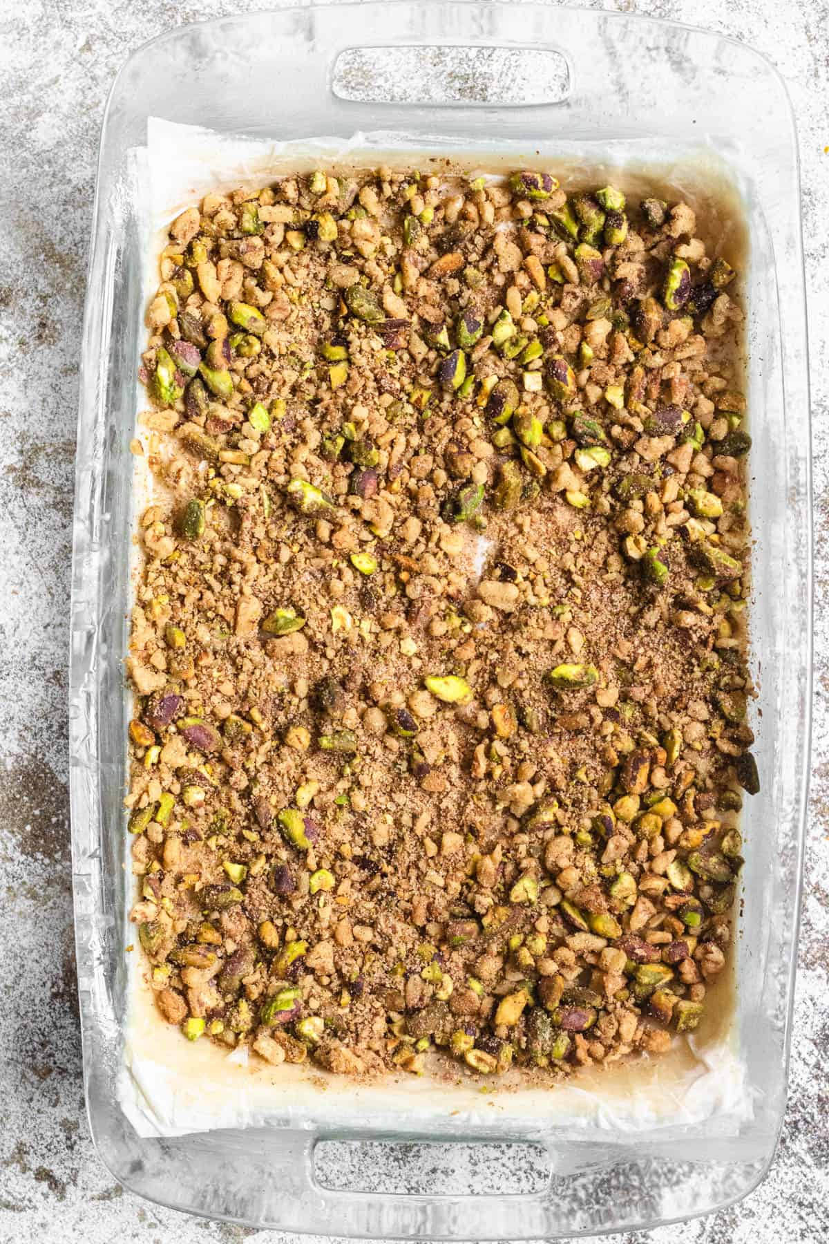 9x13 pan with nut mixture laid over the phyllo dough