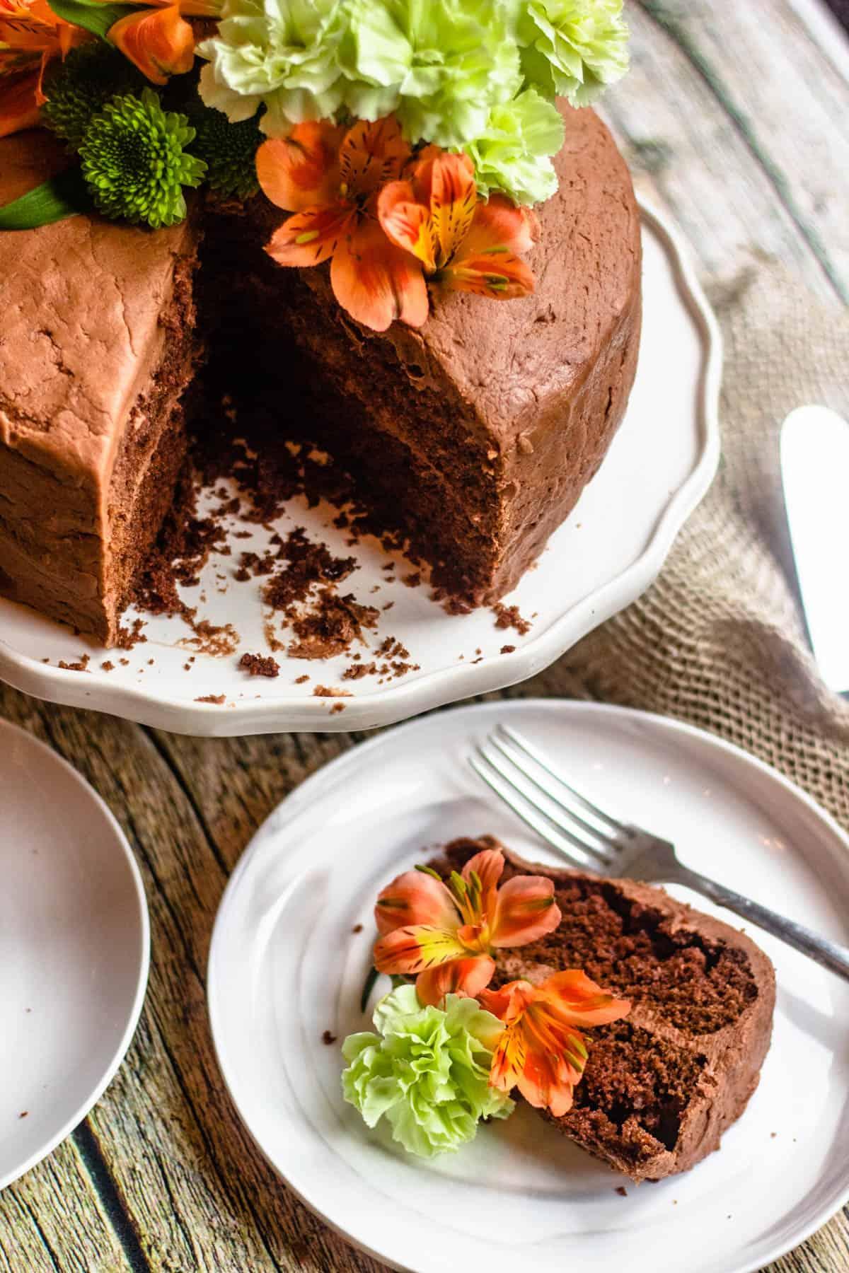 Piece of cake next to cake pans