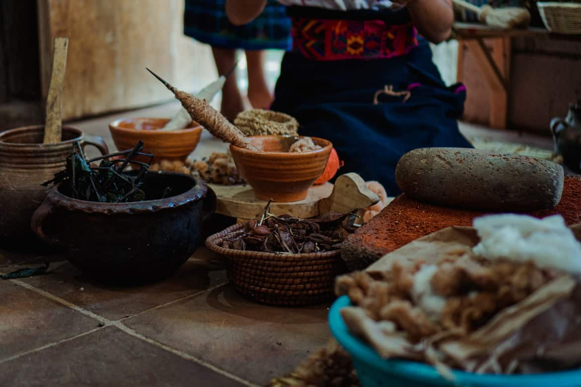 a spread of Guatemalan food on the floor