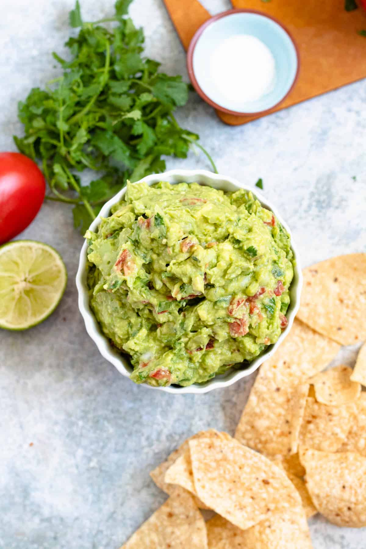 Overhead of white bowl filled with guacamole