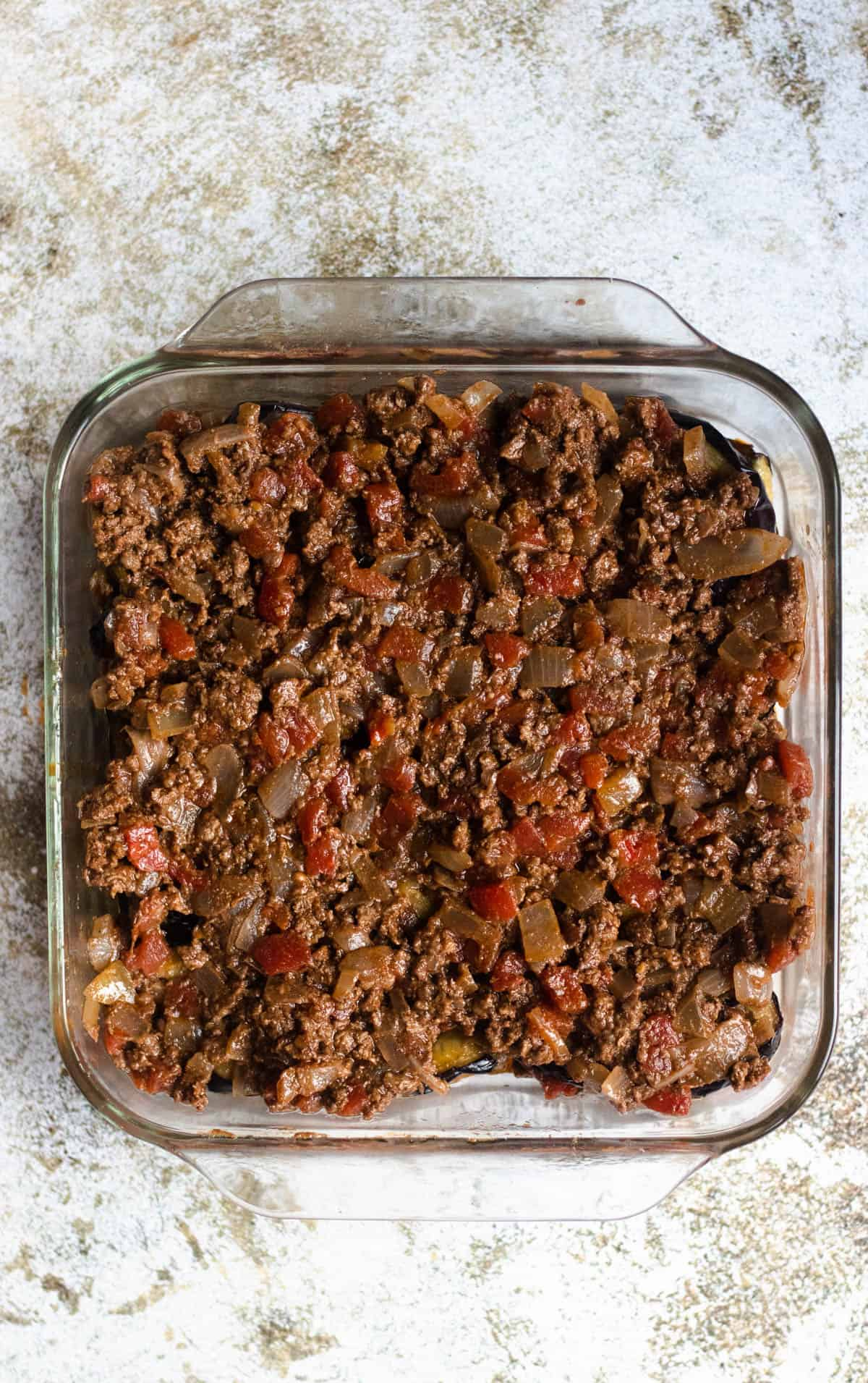 beef and tomato mixture in a glass dish
