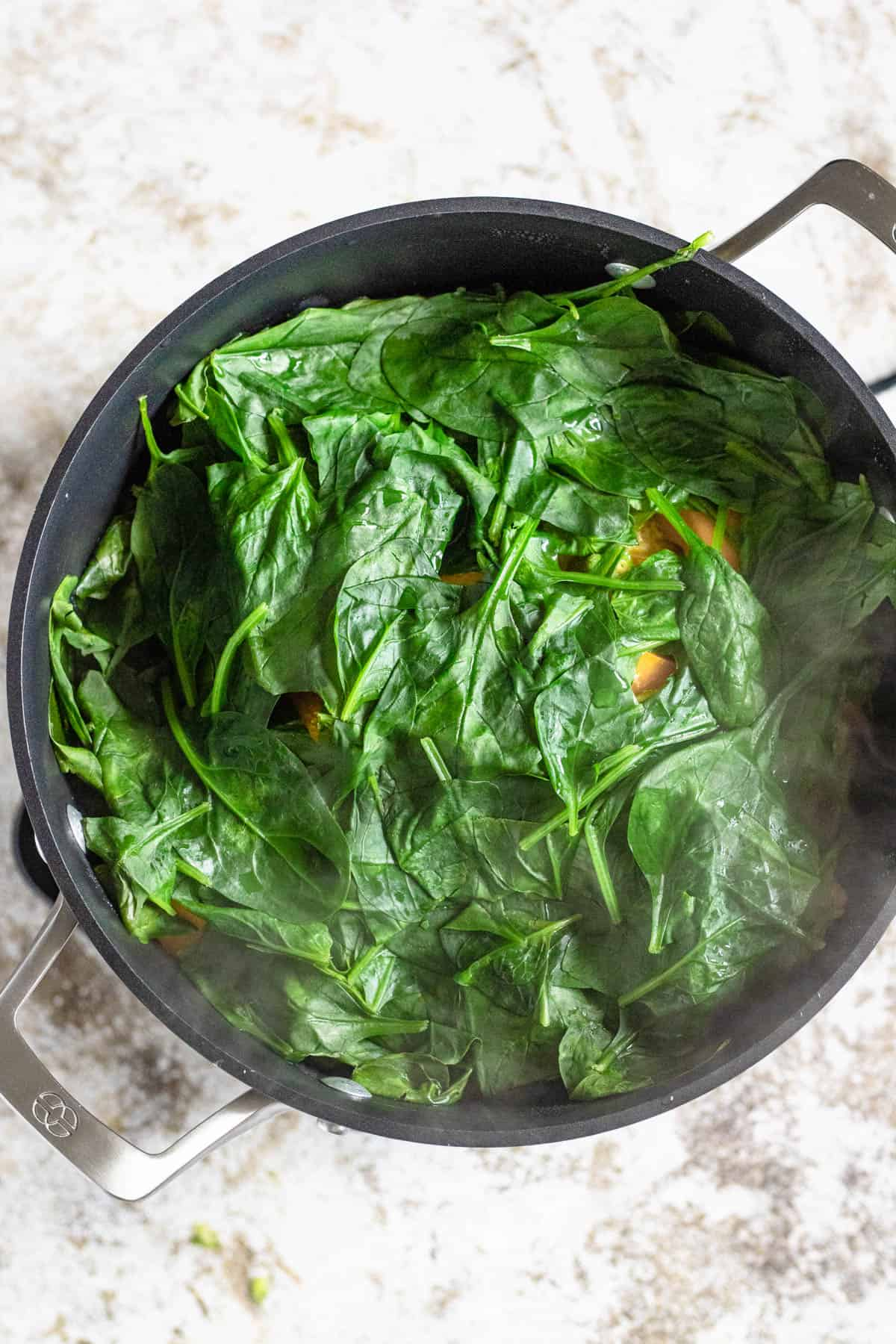 Cooked Oil down with wilted spinach