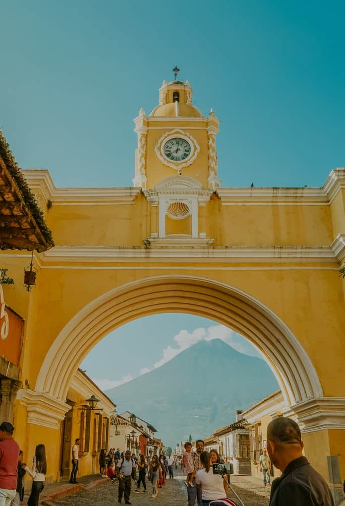 Yellow arch with a clock tower in Guatemala
