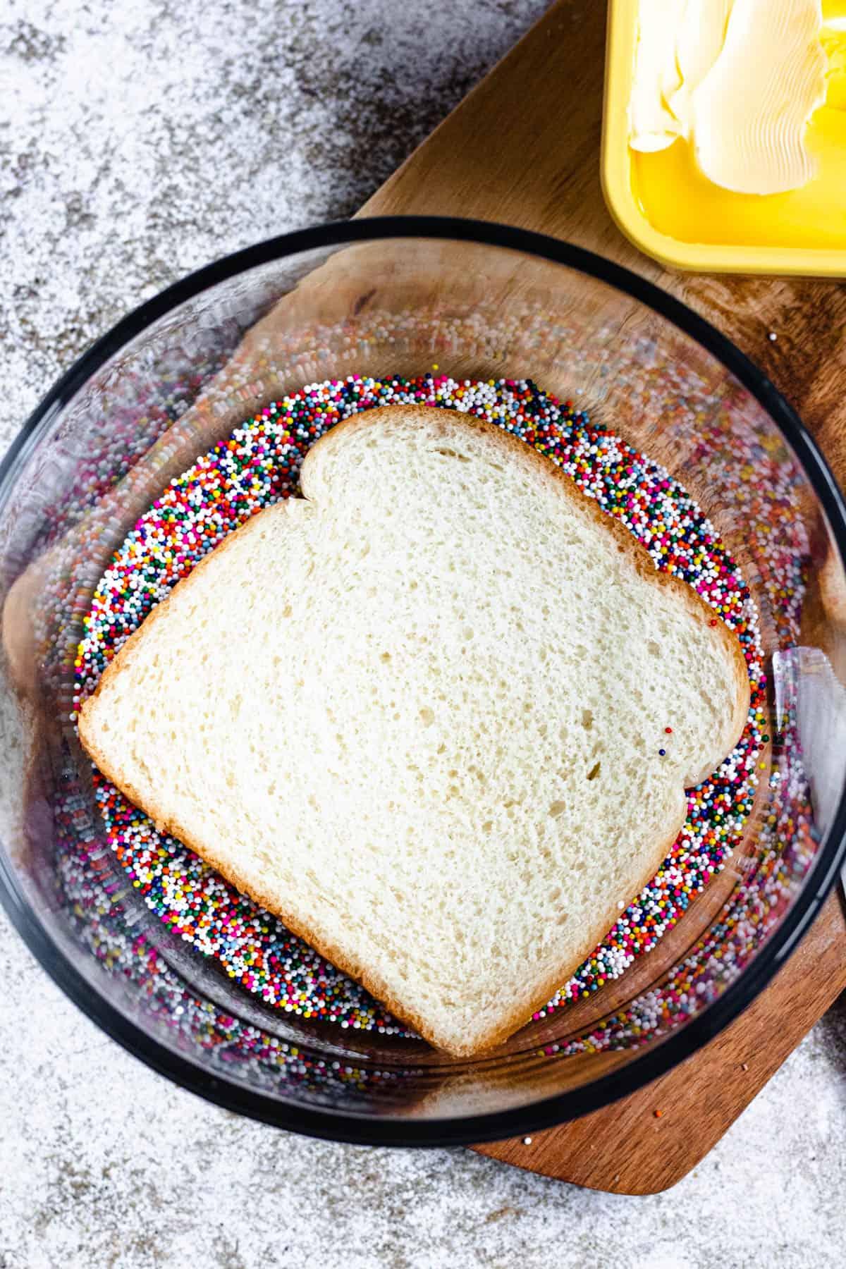 Bread in a bowl of sprinkles