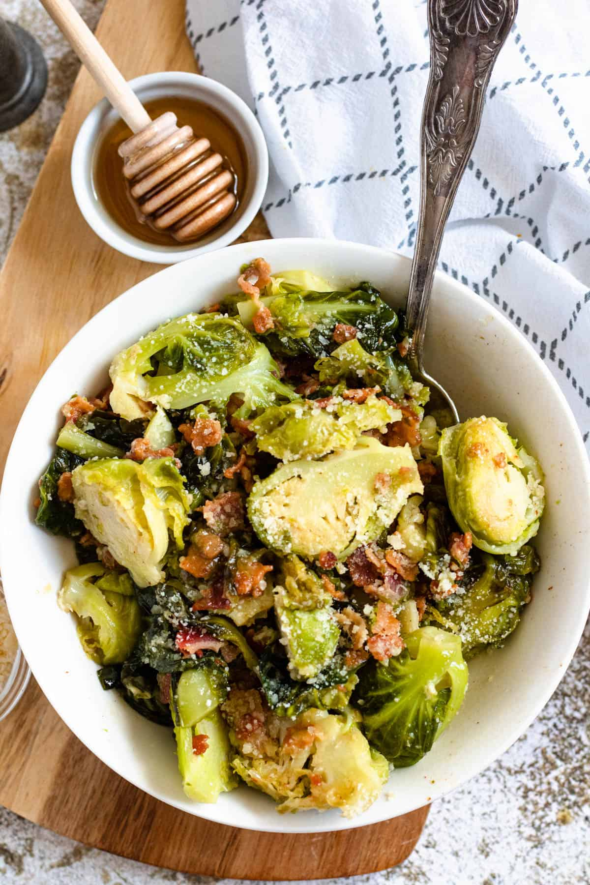 Bowl of Brussels sprouts with bacon and honey