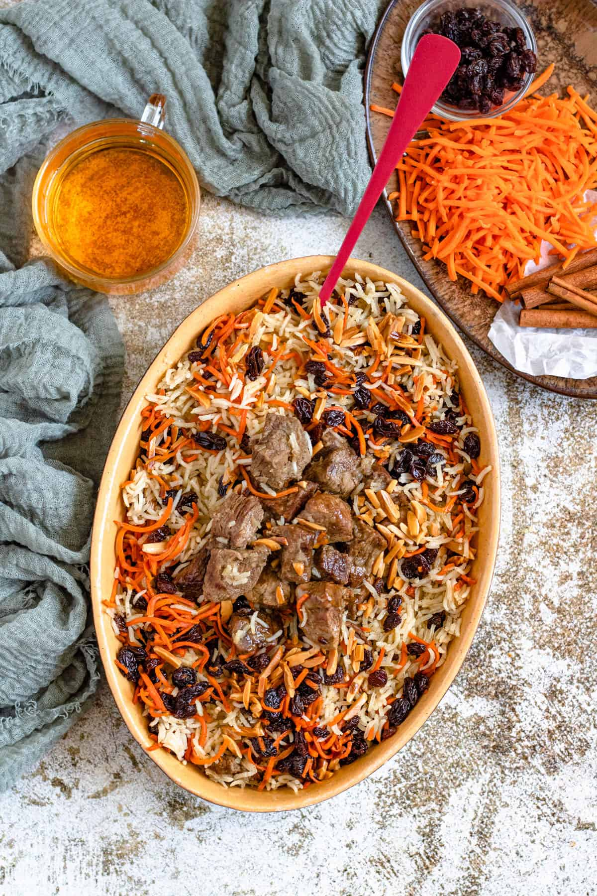 Platter of Kabuli Pulao with carrots and almonds and raisins