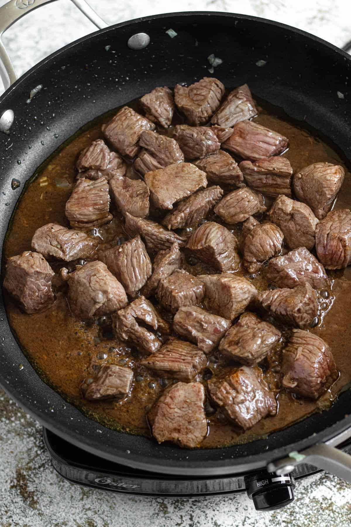 Cooked lamb in a pan with ghee