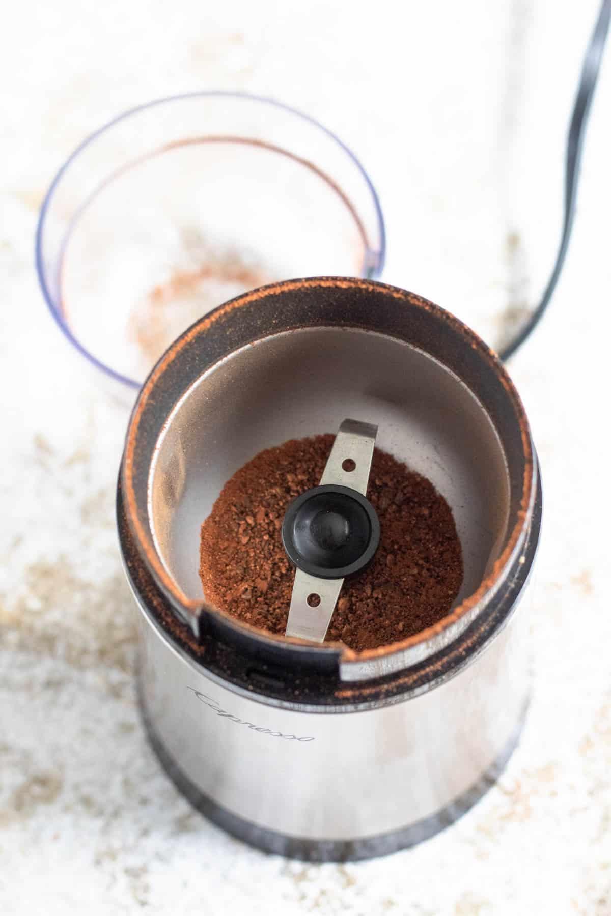 Ground cinnamon in a spice grinder