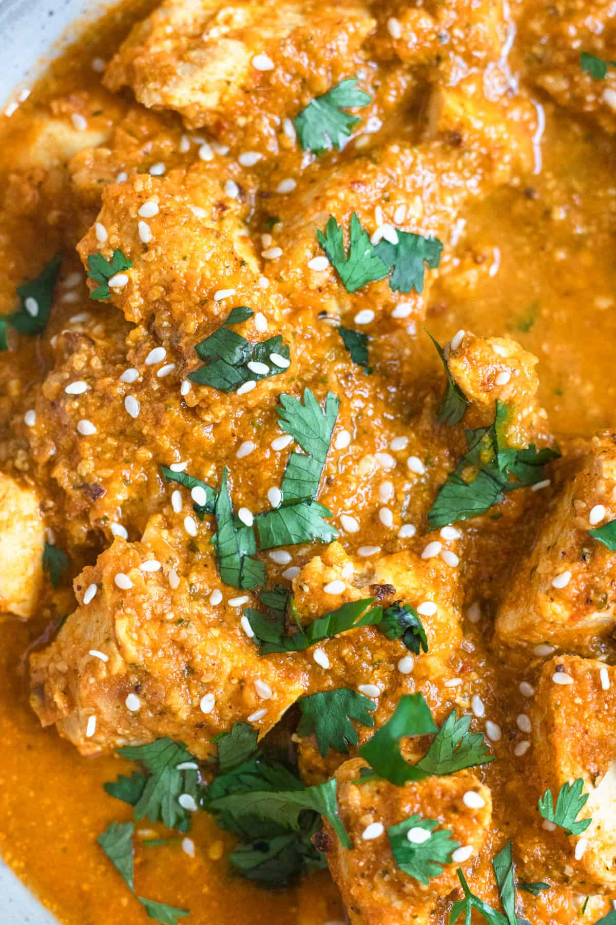 Close up of chicken in sauce