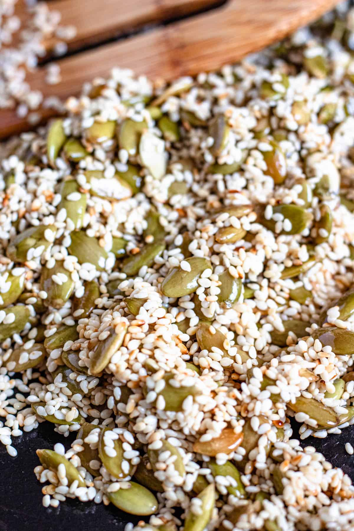 Close up of toasted sesame seeds and pumpkin seeds